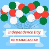 美国独立日在马达加斯加 也corel凹道例证向量 旗子和象征的颜色的球与题字 免版税库存图片