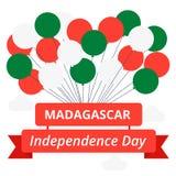 美国独立日在马达加斯加 也corel凹道例证向量 旗子和象征的颜色的球与题字 免版税库存照片