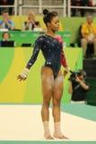 美国的奥林匹克冠军加布丽埃勒・道格拉斯在自由体操竞争在妇女` s全能体操资格时 图库摄影