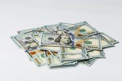 美国的许多捆绑100美元被隔绝的钞票 库存照片