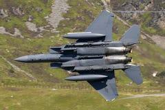 美国空军F-15E罢工老鹰飞行通过马赫圈 库存图片