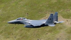 美国空军F-15E罢工老鹰飞行通过马赫圈 图库摄影