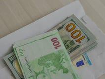 美国美元和欧元钞票 免版税库存图片
