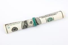 美国美元钞票在被隔绝的管滚动了在白色 库存图片