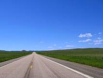 美国西方国家(地区)空的漫长的路 免版税库存照片