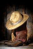 美国西部圈地牛仔帽和西部起动 免版税库存照片