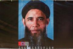美国贝拉克・奥巴马的前总统的形象化作为一个恐怖分子的有在间谍活动美国小室显示的胡子的  免版税库存照片