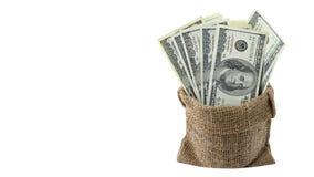 美国金钱在白色背景隔绝的袋子的一百元钞票 堆美国100钞票 图库摄影
