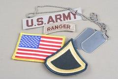 美国陆军一等兵茂盛的补丁、别动队员选项、旗子补丁和卡箍标记 免版税库存照片