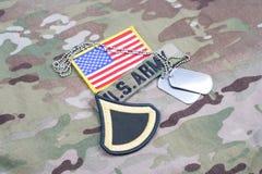美国陆军一等兵茂盛的补丁,旗子补丁,与在制服的卡箍标记 库存照片