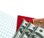 美国,乌克兰金钱、护照和报纸。 免版税库存图片