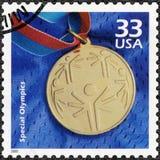 美国- 2000年:展示奥运金牌奖牌,致力特别奥林匹克,系列庆祝世纪, 20世纪90年代 图库摄影