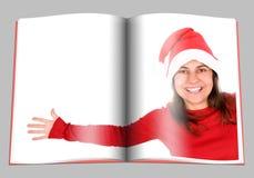 美女杂志页圣诞老人妇女 图库摄影