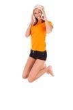 年轻美好亚洲妇女跳跃喜悦-亚裔人民 图库摄影