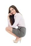 美好妇女蹲下 免版税库存图片