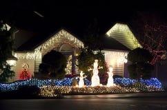 美好家庭房子圣诞灯点燃 免版税图库摄影