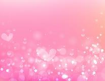 美好的圈子和心脏在桃红色背景 库存照片