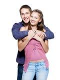 美好的夫妇愉快的微笑的年轻人 图库摄影