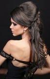 美好的头发发型丰富的妇女 免版税库存图片