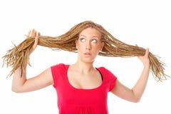 美好的女孩发型许多褶 免版税库存照片