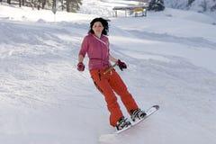 美好的女孩snowborder 免版税库存照片
