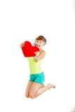 美好的妇女举行情人节爱标志画象  库存图片