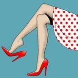 美好的妇女腿葡萄酒图画在红色高跟鞋的 免版税库存照片