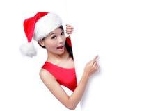 美好的广告牌圣诞节女孩显示微笑 免版税库存照片