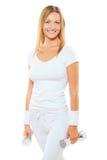 美好的微笑的女运动员佩带的白色体育给holdi穿衣 免版税图库摄影