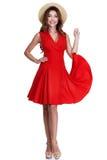 美好的性感的妇女长的深色的头发穿戴红色棉花礼服st 库存图片