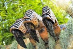 美好的恐龙雕塑显示天视图在公园 免版税图库摄影
