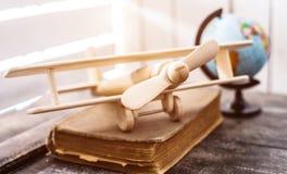 美好的手工制造木玩具飞机 免版税库存照片