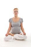 美好的执行的怀孕的放松女子瑜伽 免版税库存图片