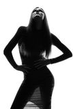 美好的明亮的深色的黑暗的方式女孩魅力她的高嘴唇查找构成镜子纵向红色反映性感的表 美好的性感的时髦的模型魅力画象  库存照片