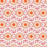 美好的橙色和红色卷曲线的无缝的样式 免版税库存图片