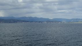 美好的海风景用爱奥尼亚海清楚的绿松石水  蓝色盐水湖海滩海岸, Kassiopi,科孚岛海岛,希腊 股票录像