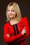 美好的白肤金发的礼服女孩红色 免版税库存照片