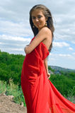 美好的礼服女孩红色 免版税库存图片