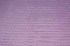 美好的紫色背景 织品纹理 库存图片