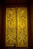 美好的老挝人寺庙门 免版税库存图片