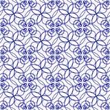 美好的蓝色卷曲线的无缝的样式 库存图片