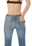 美好的身体女性佩带的牛仔裤。 免版税库存图片