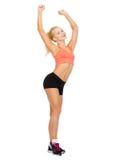 美好的运动的妇女跳舞 免版税库存图片