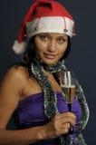 美好的香槟圣诞节饮用的妇女 免版税库存图片
