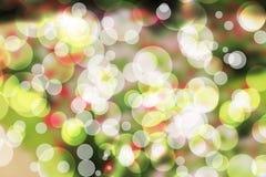 美好的Bokeh背景被弄脏的墙纸绿色红色 免版税库存图片