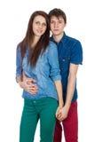 美好年轻微笑的夫妇拥抱 库存图片