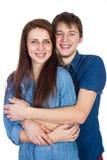美好年轻微笑的夫妇拥抱 库存照片