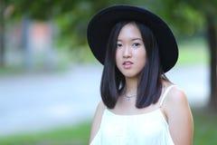 美妙的女性帽子亚洲人 库存图片