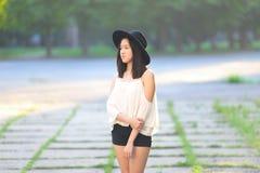 美妙的女性帽子亚洲人 库存照片