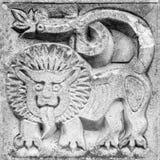 美妙的狮子,浅浮雕 库存照片